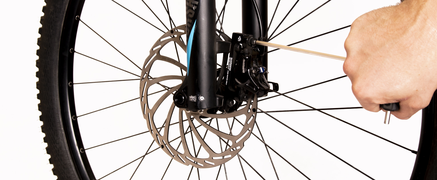 How to adjust a disc brake?